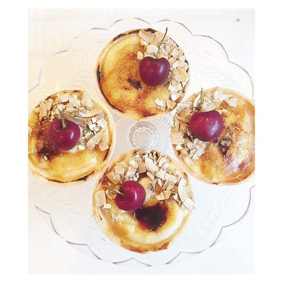 Custard brulee tarts topped with gold almonds and cherries #patisserie