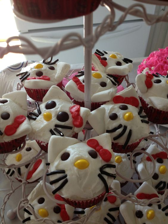 Hello Kitty cupcakes so fun to make. You just need mini m, skittles, marsh mellows, Wilton cherry black licorice!  So easy!