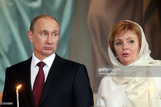 Russia's Prime Minister Vladimir Putin (L) and his wife Lyudmila Putina (R) pray…