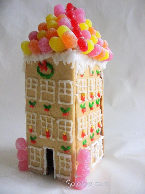 Lovely gingerbread tall house with gumdrops piled on roof