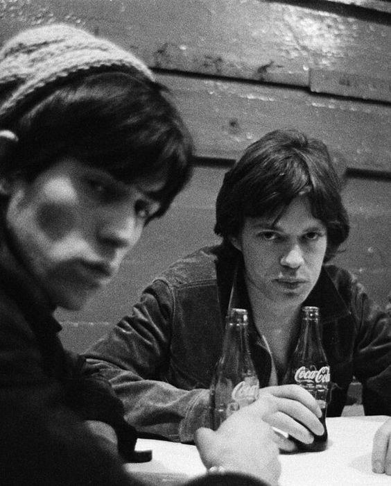 Keith Richards and Mick Jagger sharing a Coke