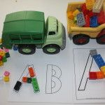 legos delivered by truck to build letters