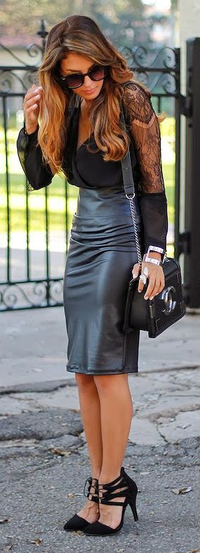 black blouse, curled hair, black pumps. need leather pencil.
