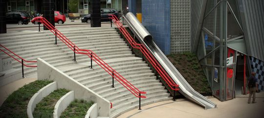 It's officially called a 'transfer accelerator' by Dutch railway maintenance company ProRail, but everyone else would say it's a slide. An awesome slide. Installed next to a stairway at the newly renovated railway station Overvecht in the city of Utrecht, the slide offers travellers the opportunity to quickly reach the railway tracks when they're in a hurry. But above all, the slide is a great instrument to make the city more playful. The 'transfer accelerator' was designed by Utrecht-based…
