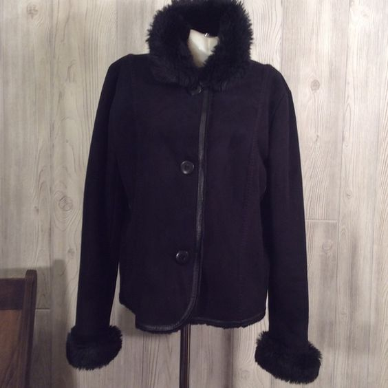 Coldwater creek faux fur and faux suede jacket Pretty black with black faux fur on collar and at wrists. Inside is also faux fur. Two front pockets with buttons up front. Has real leather trim up front and around bottom which is a very thin band. Very pretty. Very good condition for a pre loved jacket. Coldwater Creek Jackets & Coats