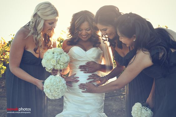 This photo takes my breath away because it completely captures the excitement of the expecting bride. A great photo of a pregnant bride sharing a beautiful moment with her bridal party. Vineyard Wedding in Napa, CA. Photography by Novak Photos, San Diego, CA I Wedding Coordination by Bliss Event Productions, Benicia, CA