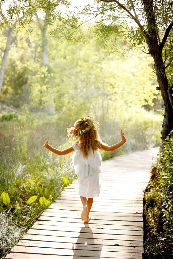 I walked behind her, knowing this perfect moment wouldn't last forever. She would grow up, find her own way. And I would always remember the sunlight on the water, her arms outstretched in wonder, my hand holding petals that fell from her tiara as she ran ahead ... (words by Laura McHale Holland)