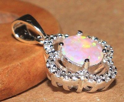 Very elegant fire opal cubic zircon pendant ! Total Weight: 2.5 gr(0.09…