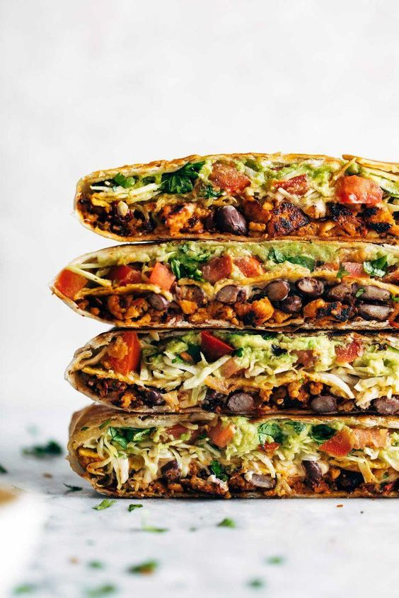 This vegan crunchwrap is INSANE! Stuff this bad boy with whatever you like - I made it with sofritas tofu and cashew queso - and wrap it up, fry, and devour! Favorite vegan recipe to date. #vegan #veganrecipe #crunchwrap #vegancrunchwrap #sofritas #cashewqueso | pinchofyum.com #vegetarianpastadishes