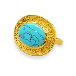 The sizable turquoise-colored center stone of this ring is the sort of gem that would easily earn Cleopatra's stamp of approval.