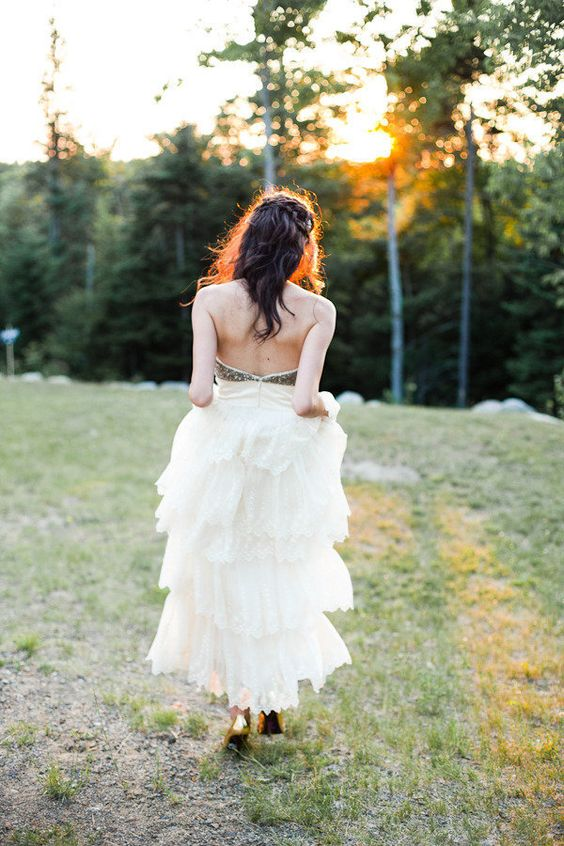 a carefree Bride in her sparkling BHLDN dress  Photography by mandjphotos.com