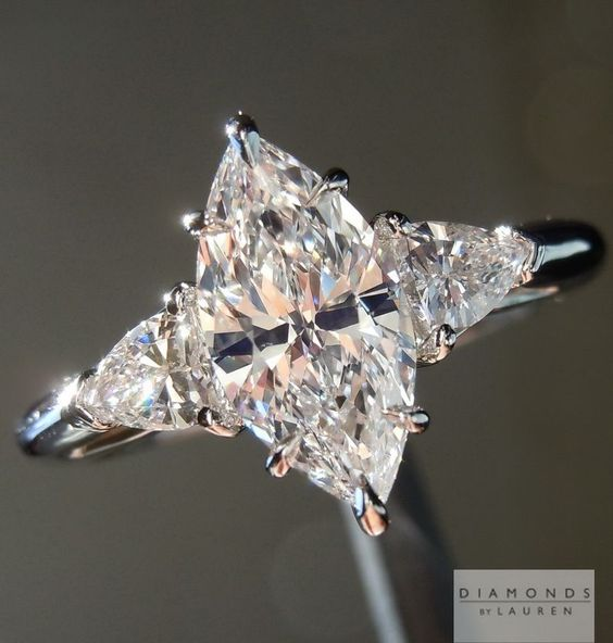 marquise diamond ring with shield side stones
