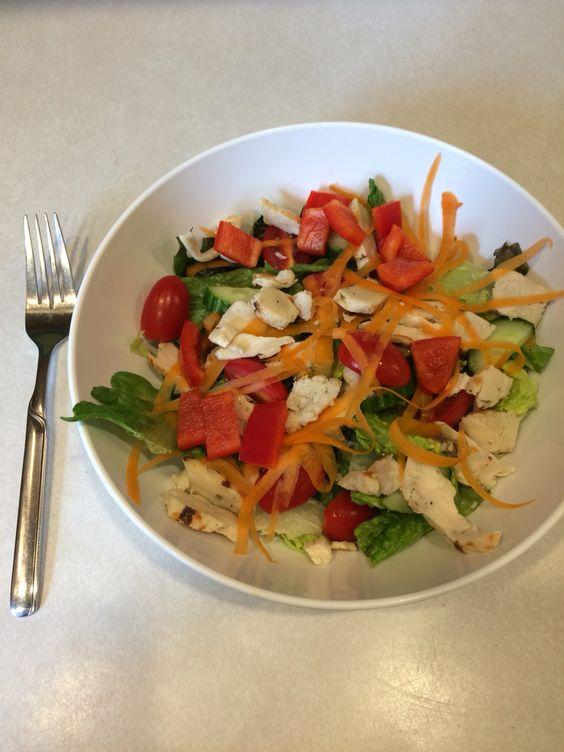 Lettuce, chicken, cucumber, red pepper, shredded carrot, grape tomatoes