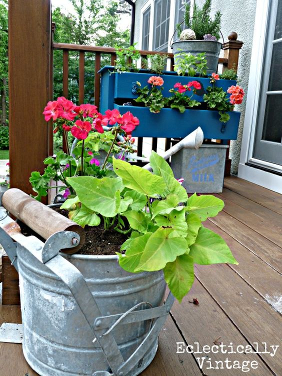 Unique garden containers with a mop bucket planter gardens decks and other - Unique container gardening ideas ...