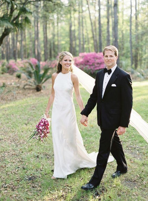 Camera Eubanks and Dr. Jason Wimberly holding hangs in wedding dress and tux http://itgirlweddings.com/cameran-eubanks-southern-wedding/