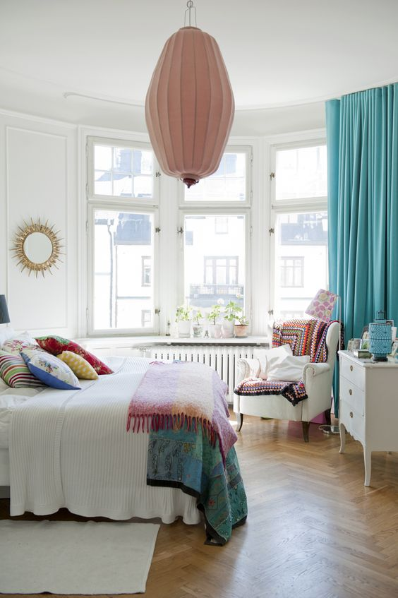 Lovely white bedroom with splashes of colour!
