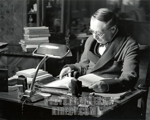 H g wells at writing desk british author and sociologist