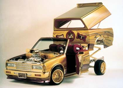 Lowrider Cars And Trucks WIth Gold And Chrome Rims