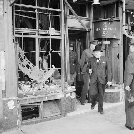 The Prime Minister Winston Churchill inspects bomb damage caused by Luftwaffe night raids in Ramsgate, Kent, England on 28 August 1940.