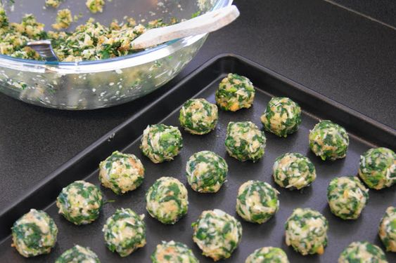 Spinach Balls. These were just okay. Made closer to 30 than 60 like the recipe says. For the love of kittens, use a tiny muffin tin for these. I did two batches in tins and one free form. The tins cooked more evenly and were more aesthetically pleasing. I probably won't make these again.