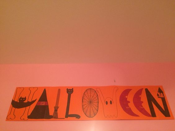 DIY Halloween sign  4 and 1/2 Orange 12x12 papers. Drew with pencil first and then went over with sharpie then colored them it.