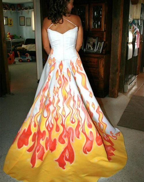 """Ugly Wedding Dresses You Won't Believe People Wore: Flaming Dress - Somehow I don't think """"The Girl on Fire"""" would approve. Flames can be cool, you know, on a matchbox car, but that's probably where they should stay."""