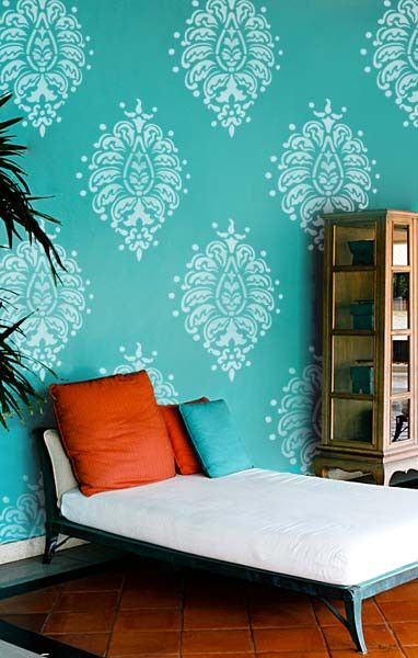 ... on turquoise wall. Easy way to transform an accent wall with stencils