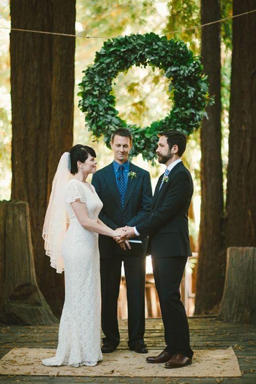 A wreath is a great ceremony backdrop, no matter the season | Brides.com