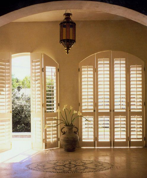 Cool serenity provided by shutters, always a good anchor for a room.