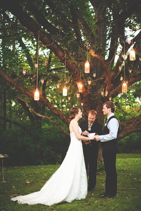 Light up your outdoor wedding with lanterns strung throughout the trees | Steven Michael Photo: