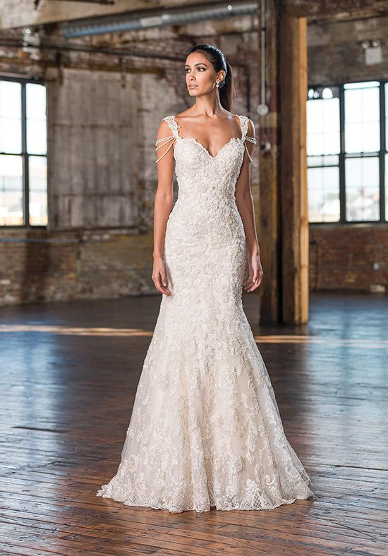Highlight your arms with draped pearl strands attached to this fit and flare gown also showcasing a sweetheart neckline, beaded lace, and sweep train.