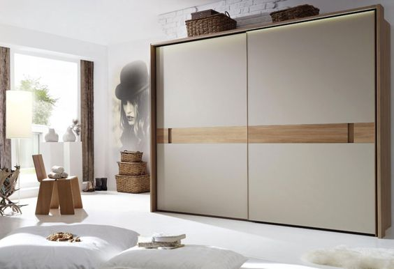The Most Popular Choices for Wardrobe with Sliding Doors Stylish Wardrobe Design With Modern Sliding Doors For Minimalist Bedroom Ideas With Unique Wallpaper
