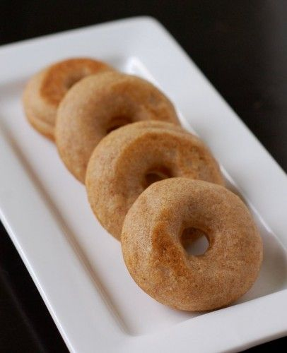 Baked whole-grain donut recipe from 100 Days of Real Food.  These recipes are for a donut maker but I wonder if it would work to bake in a donut pan....