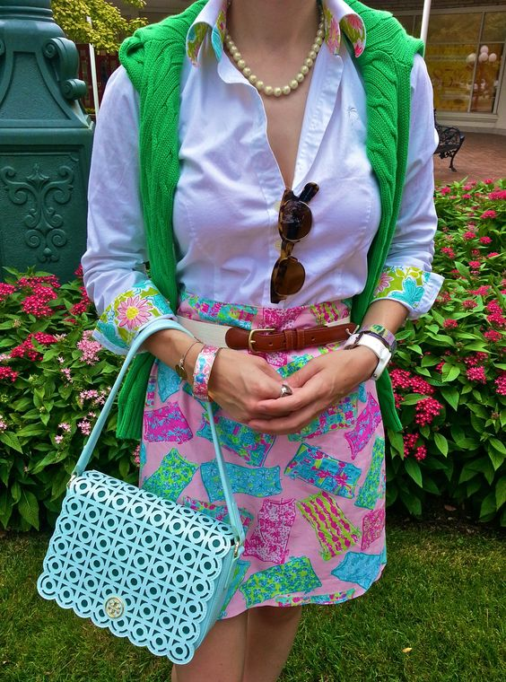I want this skirt!  semperpreparatus:  OOTD: Labor Day Lilly. Shirt: Lilly Pulitzer Skirt: Lilly Pulitzer Sweater: Ralph Lauren Belt: Coach Purse: Tory Burch Pe...
