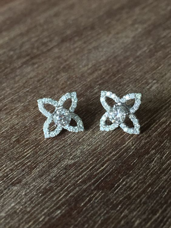 One of the biggest jewelry staples: #diamond studs. The flower earring jackets are an add on for even more sparkle. #jewelrystaple www.wadedesignsjewelry.com