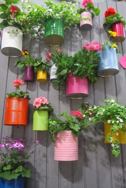 Recycled cans and little bit paint, so colorful and cute! Great idea for a little herb garden!: