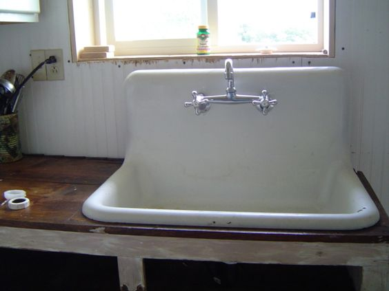 White old kitchen sink made of ceramic material and ...