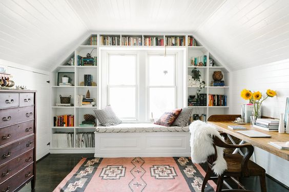 tiny house decorating inspiration - white built ins + window seat. good addition to the living room for more storage and organization.