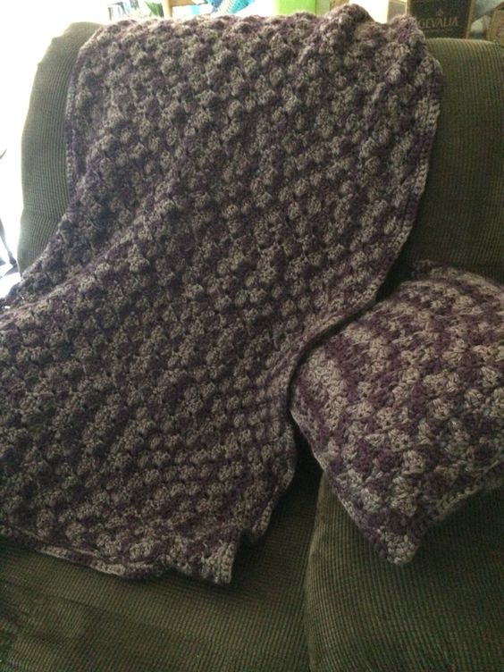 Recliner blanket w/ matching pillow. Shades of purples.