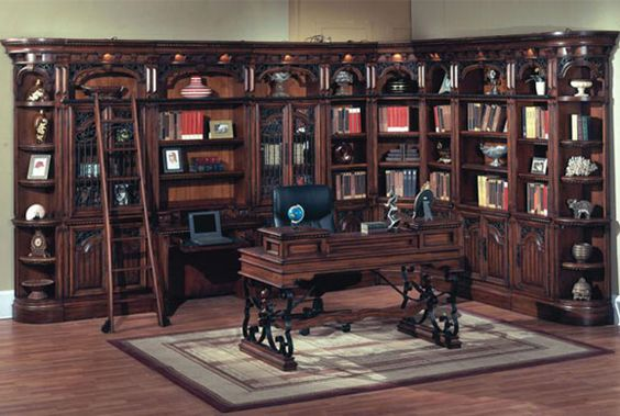 library room with walls lined with book shelves and a rolling ladder