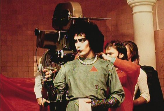 Director Jim Sharman plays with Tim Curry's pearl necklace (oooh... kinky) immediately in front of the camera.