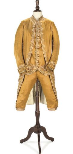 3-piece suit, 18th century. Toffee-coloured silk satin, embroidered in polychrome silks and silver metal threads, with flat self-fabric covered buttons.