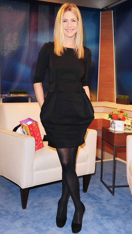 Jennifer Aniston stopped by the New York City studios of The Early Show in head-to-toe black, pairing her LBD with ebony tights and...
