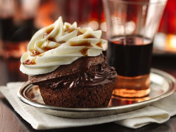 Boozy Bourbon Chocolate Cupcakes - hint of bourbon, coffee liqueur and vanilla vodka-spiked frosting - yes, please!