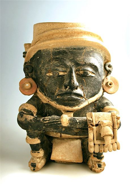 """Veracruz Seated Dignitary Origin: Mexico Circa: 300 AD to 600 AD Dimensions: 10.25"""" (26.0cm) high"""