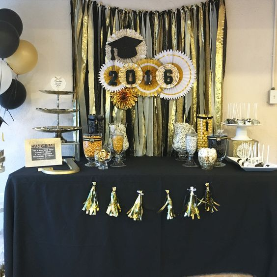 Graduation candy/dessert table.Black and gold, black and gold graduation,graduation party decor,graduation party ideas,black and gold graduation party,black and gold dessert table,black and gold centerpiece Gold black and white themed party. Gold backdrop. Fabric backdrop. Gold white and black backdrop. Photo shoot back drop.