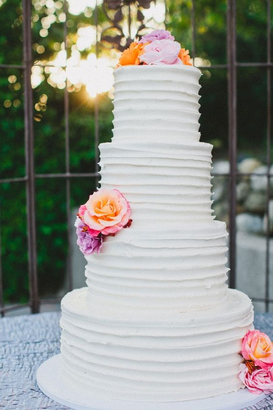 White cake with colorful flowers from Skiff's Cakes // photo by Hello Studios
