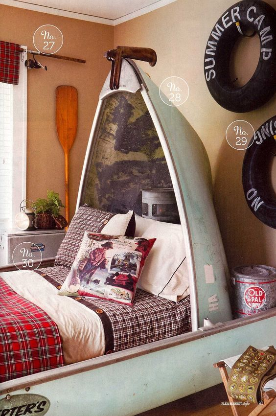 Love this idea for a camp style bedroom in a lake house. Great use of a canoe!