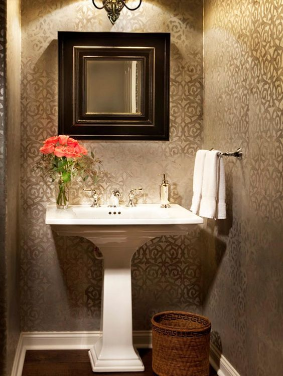 The Tone On Tone Patterned Wallpaper Define This Elegant Bathroom A Dainty Pedestal Sink And Small Mirror Keep The Focus On The Subtle Yet Shimmering