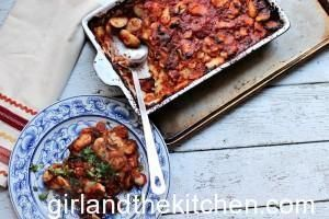 Greek Style Baked Beans -Girl and the Kitchen.  Classic taverna style large Greek beans in a savory tomato sauce.